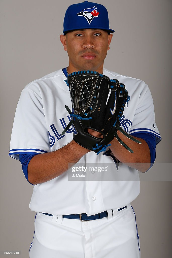 Pitcher <a gi-track='captionPersonalityLinkClicked' href=/galleries/search?phrase=Ricky+Romero&family=editorial&specificpeople=809221 ng-click='$event.stopPropagation()'>Ricky Romero</a> #24 of the Toronto Blue Jays poses for a photo during photo day at Florida Auto Exchange Stadium on February 18, 2013 in Dunedin, Florida.