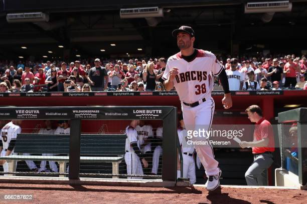 Pitcher Robbie Ray of the Arizona Diamondbacks runs onto the field for introductions before the MLB opening day game against the San Francisco Giants...