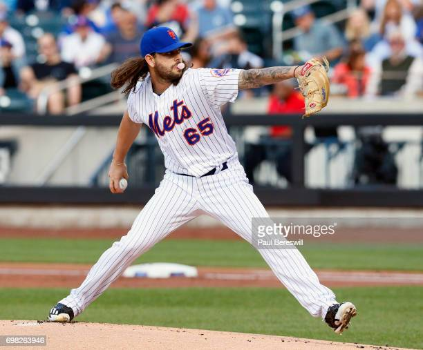 Pitcher Robert Gsellman of the New York Mets blows a gum bubble as he pitches during an MLB baseball game against the Washington Nationals on June 15...