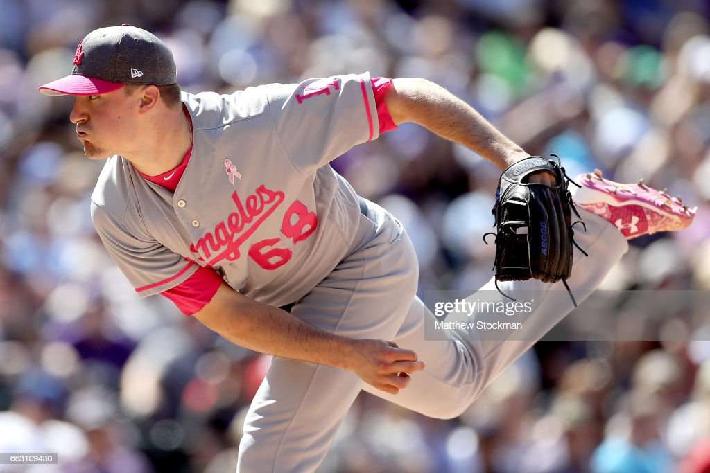 Pitcher Ross Stripling #68 of the Los Angeles Dodgers throws in the sixth inning against the Colorado Rockies at Coors Field on May 14, 2017 in Denver, Colorado. Members of both teams were wearing pink in commemoration of Mother's Day weekend.