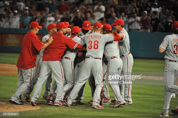 Pitcher Roy Halladay of the Philadelphia is mobbed by his teammates after pitching a perfect game against the Florida Marlins in Sun Life Stadium on...