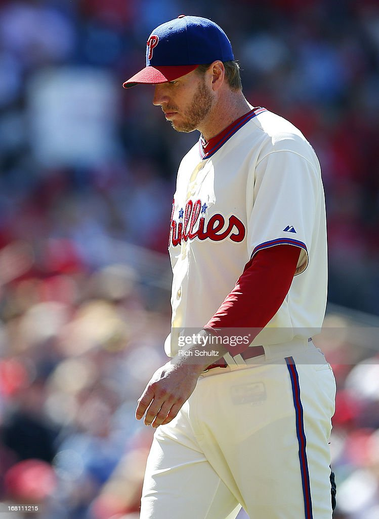 Pitcher <a gi-track='captionPersonalityLinkClicked' href=/galleries/search?phrase=Roy+Halladay&family=editorial&specificpeople=208782 ng-click='$event.stopPropagation()'>Roy Halladay</a> #34 of the Philadelphia Phillies looks dejected after being relieved in the third inning after giving up a grand slam home run to Adeiny Hechavarria of the Miami Marlins in a MLB baseball game on May 5, 2013 at Citizens Bank Park in Philadelphia, Pennsylvania.