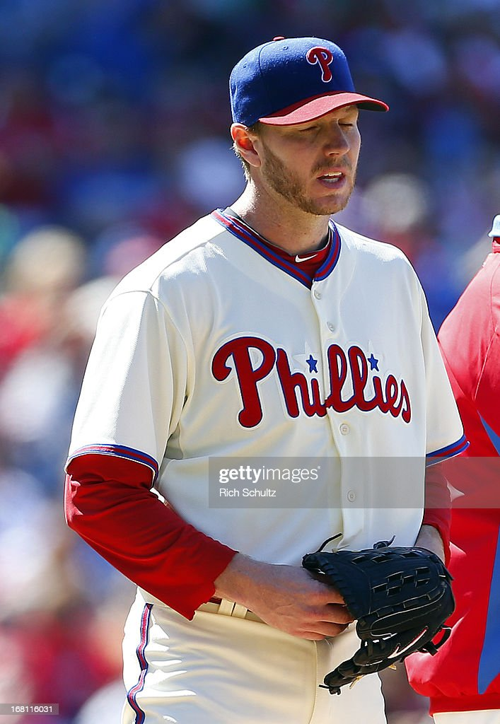 Pitcher <a gi-track='captionPersonalityLinkClicked' href=/galleries/search?phrase=Roy+Halladay&family=editorial&specificpeople=208782 ng-click='$event.stopPropagation()'>Roy Halladay</a> #34 of the Philadelphia Phillies reacts after being relieved in the third inning after giving up a grand slam home run to Adeiny Hechavarria of the Miami Marlins in a MLB baseball game on May 5, 2013 at Citizens Bank Park in Philadelphia, Pennsylvania. The Marlins defeated the Phillies 14-2.