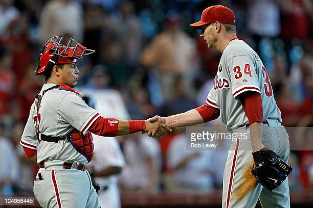 Pitcher Roy Halladay of the Philadelphia Phillies shakes hands with catcher Carlos Ruiz after 10 shutout of the Houston Astros at Minute Maid Park on...