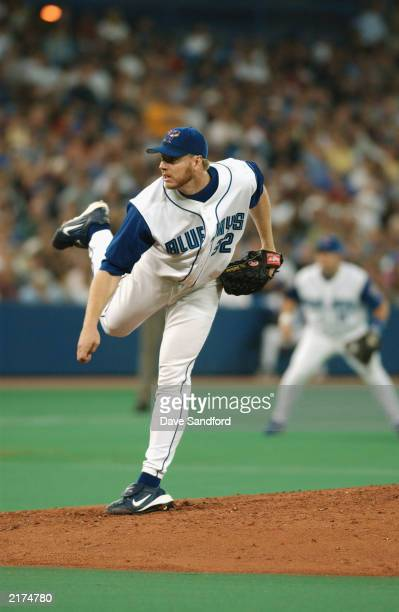 Pitcher Roy Halladay of the Toronto Blue Jays delivers a pitch during the American League game against the New York Yankees at SkyDome on July 12...