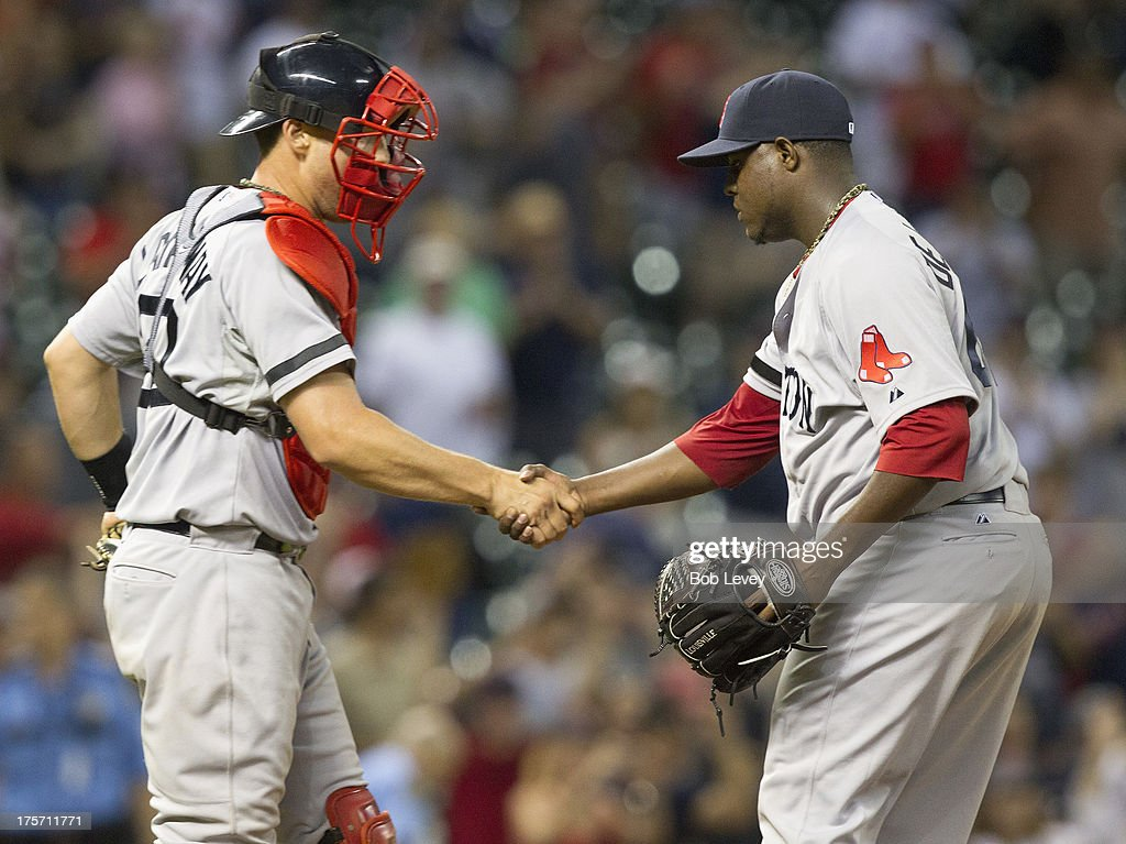Pitcher Rubby De La Rosa #62 of the Boston Red Sox shakes hands with catcher Ryan Lavarnway #20 after the final out as the Boston Red Sox defeated the Houston Astros 15-10 at Minute Maid Park on August 6, 2013 in Houston, Texas.