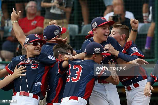 Pitcher Ryan Harlost of the MidAtlantic Team from New York is mobbed by teammates after getting the last out for a 21 win over the AsiaPacific team...