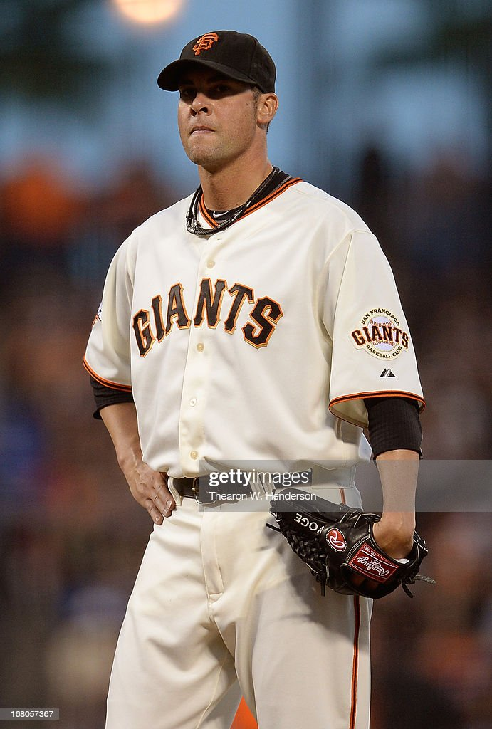 Pitcher <a gi-track='captionPersonalityLinkClicked' href=/galleries/search?phrase=Ryan+Vogelsong&family=editorial&specificpeople=670011 ng-click='$event.stopPropagation()'>Ryan Vogelsong</a> #32 of the San Francisco Giants looks on while he waits on manager Bruce Bochy #15 coming to take him out of the game against the Los Angeles Dodgers in the fifth inning at AT&T Park on May 4, 2013 in San Francisco, California.