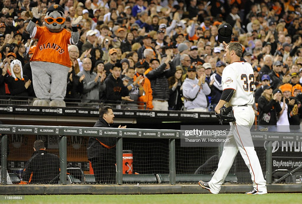 Pitcher <a gi-track='captionPersonalityLinkClicked' href=/galleries/search?phrase=Ryan+Vogelsong&family=editorial&specificpeople=670011 ng-click='$event.stopPropagation()'>Ryan Vogelsong</a> #32 of the San Francisco Giants tips his hat to the crowd after being taken out of the game with a 5-0 lead against the Los Angeles Dodgers in the seventh inning during an MLB baseball game at AT&T Park July 18, 2011 in San Francisco, California. The Giants won the game 5-0.