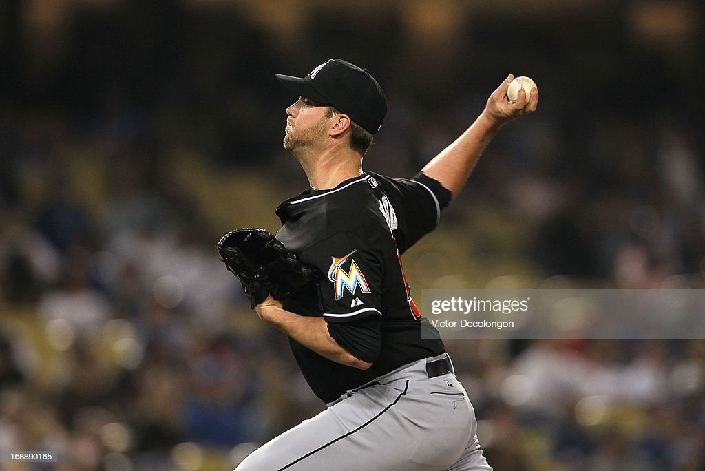 Pitcher Ryan Webb #58 of the Miami Marlins pitches in the eighth inning against the Los Angeles Dodgers during the MLB game at Dodger Stadium on May 11, 2013 in Los Angeles, California. The Dodgers defeated the Marlins 7-1.