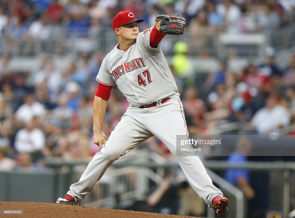 Pitcher Sal Romano #47 of the Cincinnati Reds throws a pitch in the second inning during the game against the Atlanta Braves at SunTrust Park on August 18, 2017 in Atlanta, Georgia.
