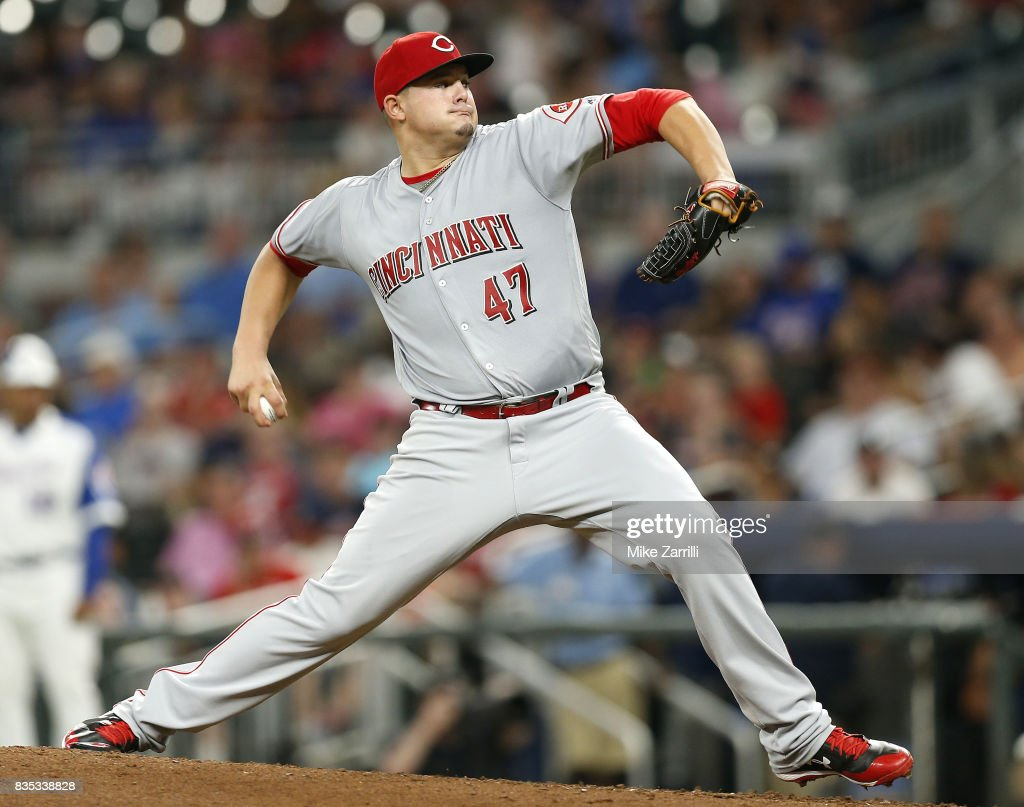 Pitcher Sal Romano #47 of the Cincinnati Reds throws a pitch in the seventh inning during the game against the Atlanta Braves at SunTrust Park on August 18, 2017 in Atlanta, Georgia.