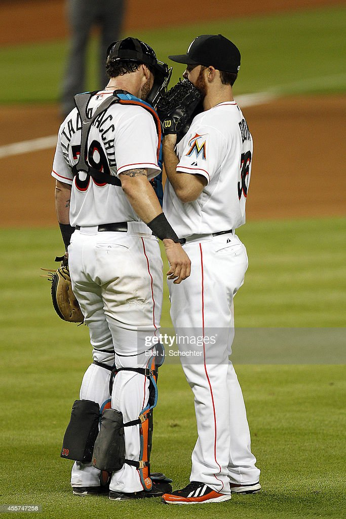 Pitcher Sam Dyson #36 of the Miami Marlins chats wit Catcher Jarrod Saltalamacchia #39 in the sixth inning against the Washington Nationals at Marlins Park on September 19, 2014 in Miami, Florida.