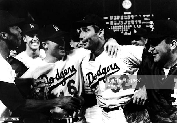 Pitcher Sandy Koufax of the Los Angeles Dodgers is mobbed by teammates Willie Davis Wes Parker Ron Fairly and Don LeJohn after pitching a perfect...