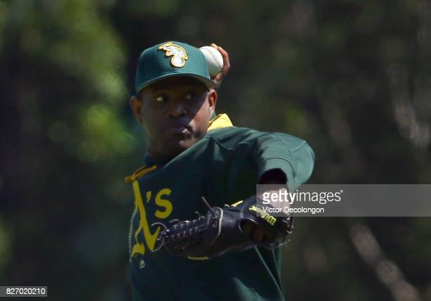 Pitcher Santiago Casilla of the Oakland Athletics throws the ball during warmup prior to the MLB game against the Los Angeles Angels of Anaheim at...