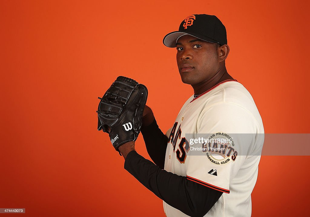 Pitcher Santiago Casilla of the San Francisco Giants poses for a portrait during the spring training photo day at Scottsdale Stadium on Febuary 23...
