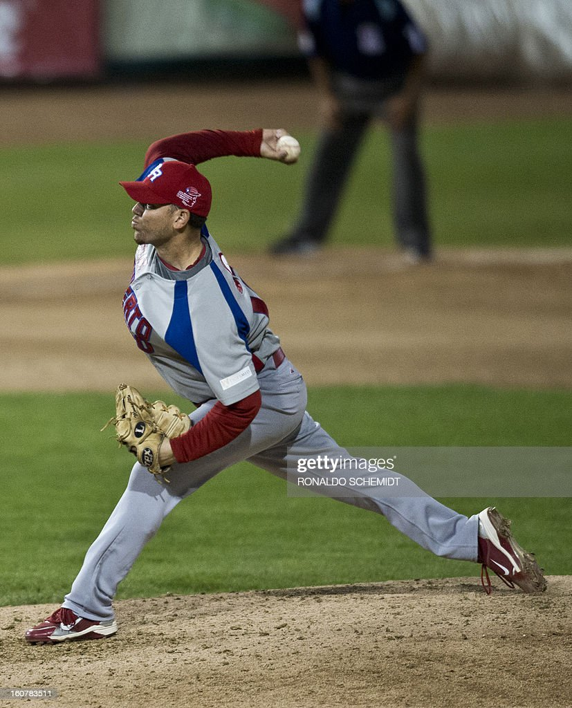 Pitcher Saul Rivera of Criollos de Caguas of Puerto Rico pitches against against Magallanes of Venezuela, during the 2013 Caribbean baseball series, on February 5, 2013, in Hermosillo, Sonora State, in the northern of Mexico. AFP PHOTO/Ronaldo Schemidt