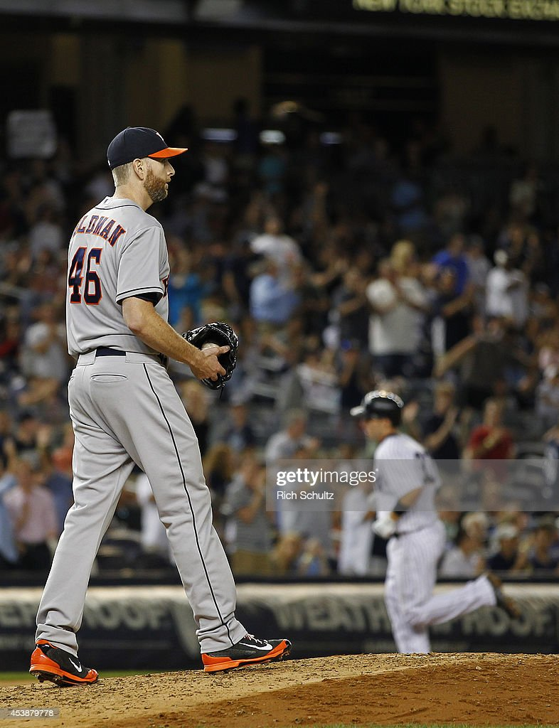 Pitcher Scott Feldman #46 of the Houston Astros walks back to the mound after giving up a home run to Stephen Drew #33 of the New York Yankees during the fourth inning of a MLB baseball game at Yankee Stadium on August 20, 2014 in the Bronx borough of New York City.