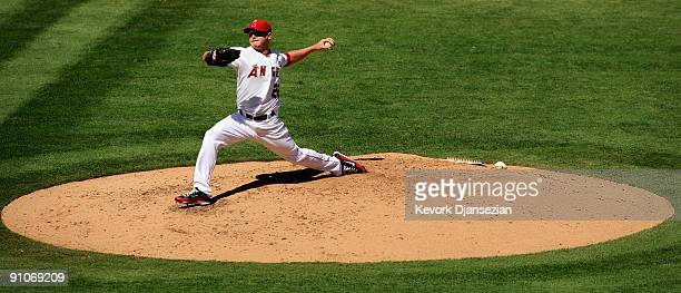 Pitcher Scott Kazmir of the Los Angeles Angels of Anaheim throws a pitch against the New York Yankees during the fourth inning at Angel Stadium on...