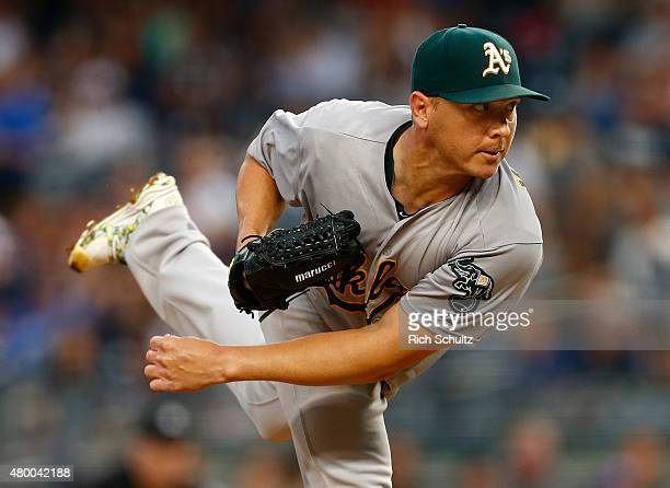 Pitcher Scott Kazmir of the Oakland Athletics delivers a pitch against the New York Yankees during the second inning of a MLB baseball game at Yankee...