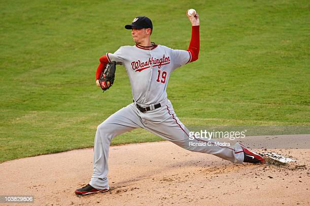 Pitcher Scott Olsen of the Washington Nationals pitches during a MLB game against the Florida Marlins at Sun Life Stadium on September 1 2010 in...