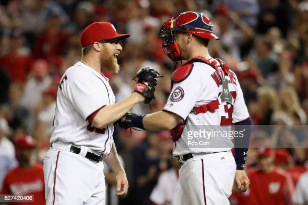 Pitcher Sean Doolittle and catcher Matt Wieters of the Washington Nationals celebrate after the Nationals defeated the Miami Marlins 32 at Nationals...