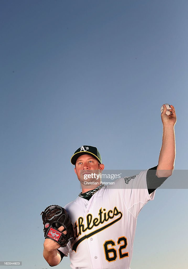 Pitcher Sean Doolittle #62 of the Oakland Athletics poses for a portrait during the spring training photo day at Phoenix Municipal Stadium on February 18, 2013 in Phoenix, Arizona.