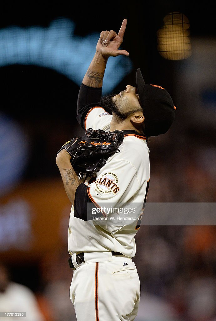 Pitcher <a gi-track='captionPersonalityLinkClicked' href=/galleries/search?phrase=Sergio+Romo&family=editorial&specificpeople=5433590 ng-click='$event.stopPropagation()'>Sergio Romo</a> #54 of the San Francisco Giants celebrate defeating the Pittsburgh Pirates 6-3 at AT&T Park on August 24, 2013 in San Francisco, California.