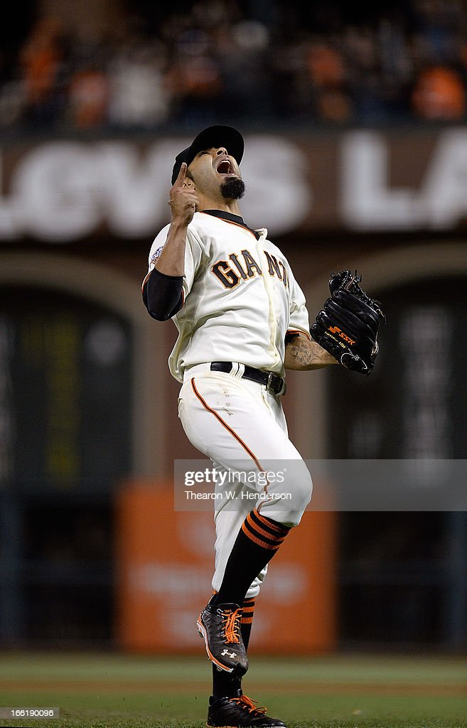 Pitcher <a gi-track='captionPersonalityLinkClicked' href=/galleries/search?phrase=Sergio+Romo&family=editorial&specificpeople=5433590 ng-click='$event.stopPropagation()'>Sergio Romo</a> #56 of the San Francisco Giants celebrates after striking out Dexter Fowler #24 of the Colorado Rockies for the final out of the game at AT&T Park on April 9, 2013 in San Francisco, California. The Giants won the game 9-6.