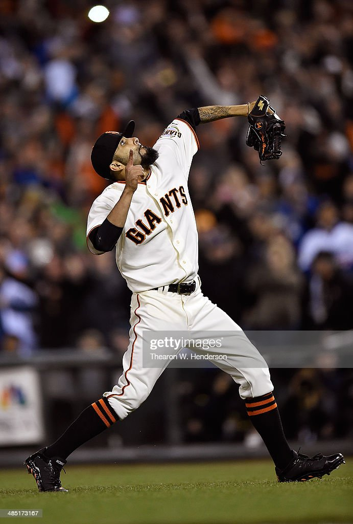Pitcher <a gi-track='captionPersonalityLinkClicked' href=/galleries/search?phrase=Sergio+Romo&family=editorial&specificpeople=5433590 ng-click='$event.stopPropagation()'>Sergio Romo</a> #54 of the San Francisco Giants celebrates deteating the Los Angeles Dodgers 2-1 at AT&T Park on April 16, 2014 in San Francisco, California. Romo pitched the ninth inning and picked up his fourth save of the season.