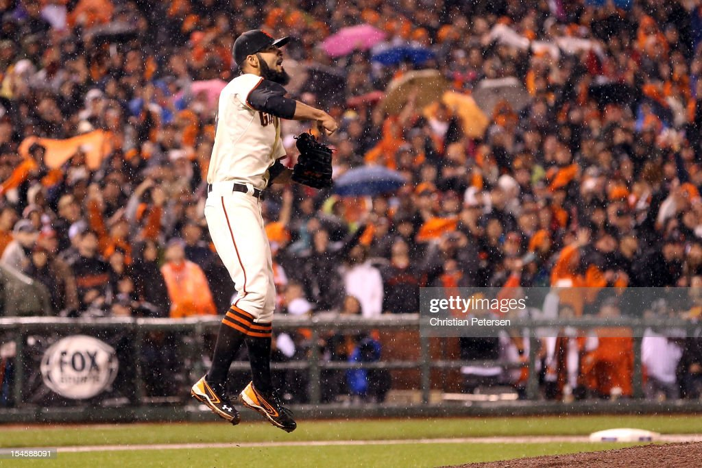 Pitcher Sergio Romo #54 of the San Francisco Giants reacts after the Giants defeat the St. Louis Cardinals 9-0 in Game Seven of the National League Championship Series at AT&T Park on October 22, 2012 in San Francisco, California.