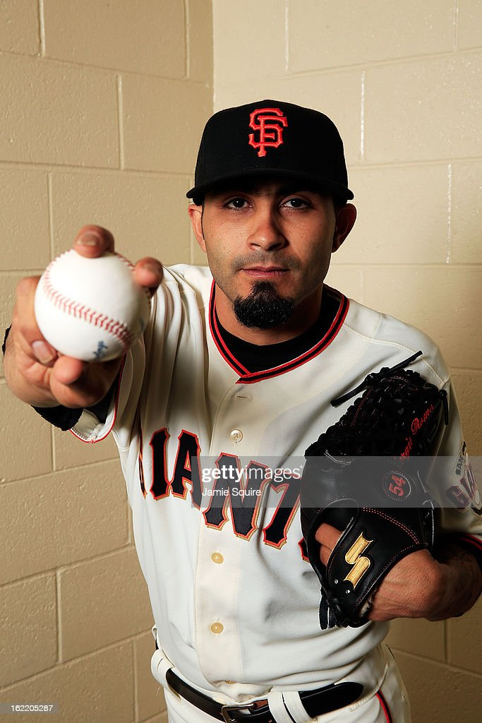 Pitcher <a gi-track='captionPersonalityLinkClicked' href=/galleries/search?phrase=Sergio+Romo&family=editorial&specificpeople=5433590 ng-click='$event.stopPropagation()'>Sergio Romo</a> #54 poses for a portrait during San Francisco Giants Photo Day on February 20, 2013 in Scottsdale, Arizona.