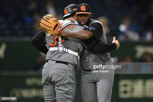 Pitcher Shairon Martis and Catcher Shawn Zarraga of the Netherlands celebrate after their 141 win in the World Baseball Classic Pool E Game Five...