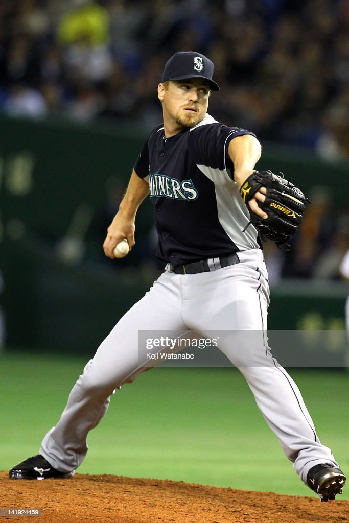 Pitcher Shawn Kelley #23 of Seattle Mariners pitches during in the bottom half of the fifth inning the pre season game between Yomiuri Giants and Seattle Mariners at Tokyo Dome on March 26, 2012 in Tokyo, Japan.