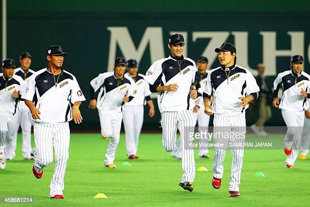 Pitcher Shintaro Fujinami of Samurai Japan with teammates during a training session at Fukuoka Yahuoku Dome on November 9 2014 in Fukuoka Japan