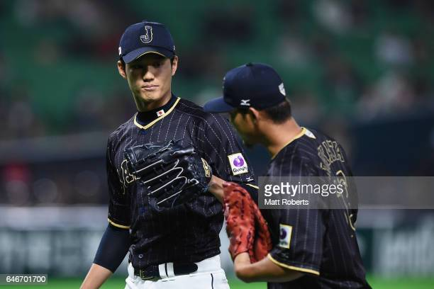 Pitcher Shintaro Fujinami high fives with infielder Sho Nakata of Japan after the bottom of the eighth inning of Japan during the SAMURAI JAPAN...