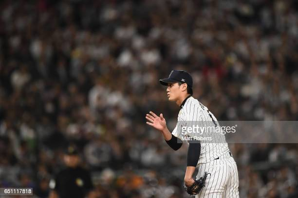 Pitcher Shintaro Fujinami of Japan signals in the top of the fourth inning during the World Baseball Classic Pool B Game Six between China and Japan...