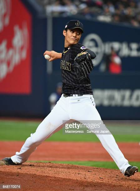 Pitcher Shintaro Fujinami of Japan throws in the bottom of the second inning during the World Baseball Classic WarmUp Game between Japan and Orix...