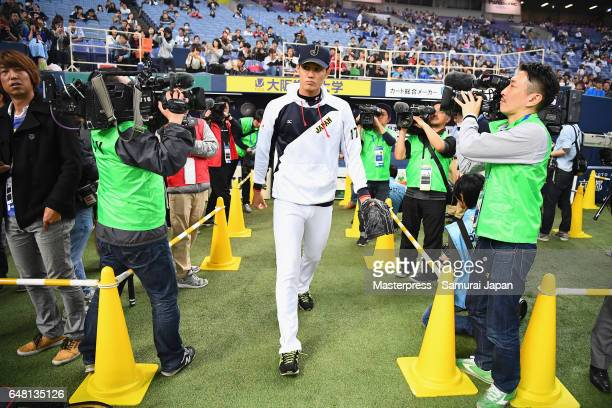 Pitcher Shintaro Fujinami of Japan walks into the field prior to the World Baseball Classic WarmUp Game between Japan and Orix Buffaloes at Kyocera...