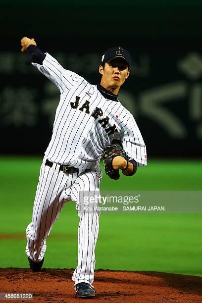 Pitcher Shintaro Fujinami of Samurai Japan in action during a training session at Fukuoka Yahuoku Dome on November 9 2014 in Fukuoka Japan