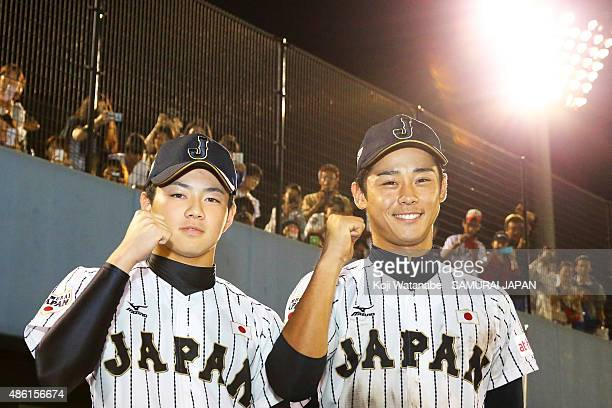 Pitcher Sho Narita and Infielder Taiga Hirasawa of Japan pose for a photograph after winning in the first round game between Japan v Mexico during...