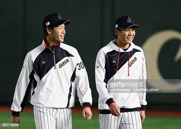 Pitcher Shota Takeda and Infielder Hayato Sakamoto of Japan warm up prior to the international friendly match between Japan and Mexico at the Tokyo...