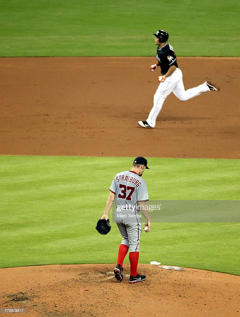 Pitcher Stephen Strasburg #37 of the Washington Nationals reacts after giving up a two-run home run to Giancarlo Stanton #27 of the Miami Marlins during the second inning at Marlins Park on July 12, 2013 in Miami, Florida.