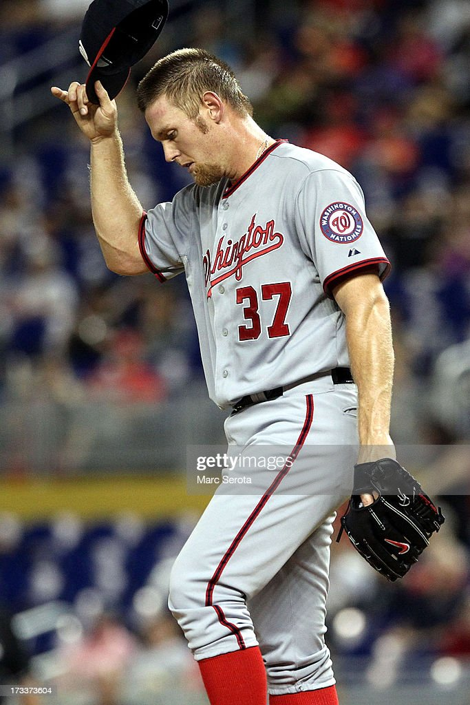 Pitcher <a gi-track='captionPersonalityLinkClicked' href=/galleries/search?phrase=Stephen+Strasburg&family=editorial&specificpeople=6164496 ng-click='$event.stopPropagation()'>Stephen Strasburg</a> #37 of the Washington Nationals reacts during the first inning against the Miami Marlins at Marlins Park on July 12, 2013 in Miami, Florida.