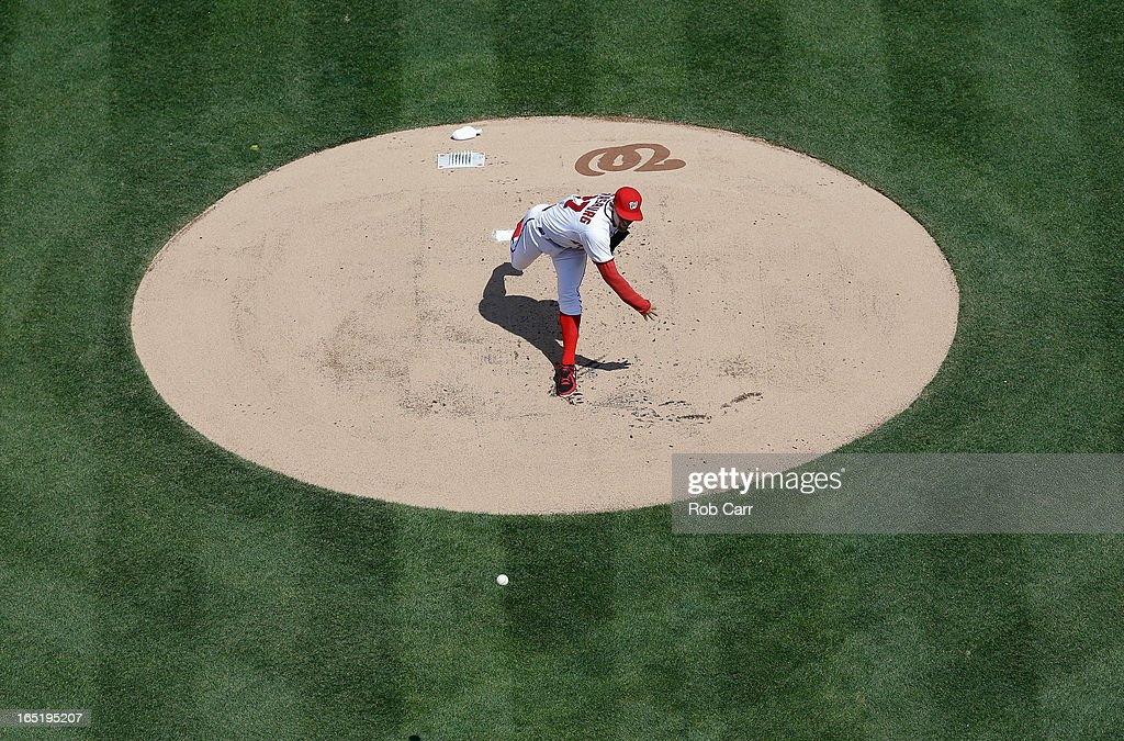 Pitcher <a gi-track='captionPersonalityLinkClicked' href=/galleries/search?phrase=Stephen+Strasburg&family=editorial&specificpeople=6164496 ng-click='$event.stopPropagation()'>Stephen Strasburg</a> #37 of the Washington Nationals throws to a Miami Marlins batter during the first inning of their opening day game at Nationals Park on April 1, 2013 in Washington, DC.