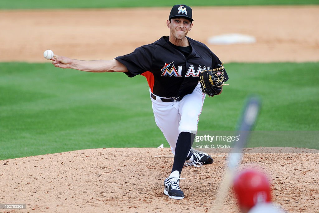 Pitcher Steve Cishek #31 of the Florida Marlins pitches during a spring training game against the St. Louis Cardinals at Roger Dean Stadium on February 23, 2013 in Jupiter, Florida.