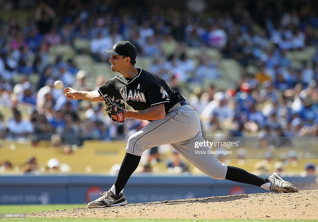 Pitcher <a gi-track='captionPersonalityLinkClicked' href=/galleries/search?phrase=Steve+Cishek&family=editorial&specificpeople=7542919 ng-click='$event.stopPropagation()'>Steve Cishek</a> #31 of the Miami Marlins pitches in the eighth inning against the Los Angeles Dodgers during the MLB game at Dodger Stadium on May 12, 2013 in Los Angeles, California. The Dodgers defeated the Marlins 5-3.