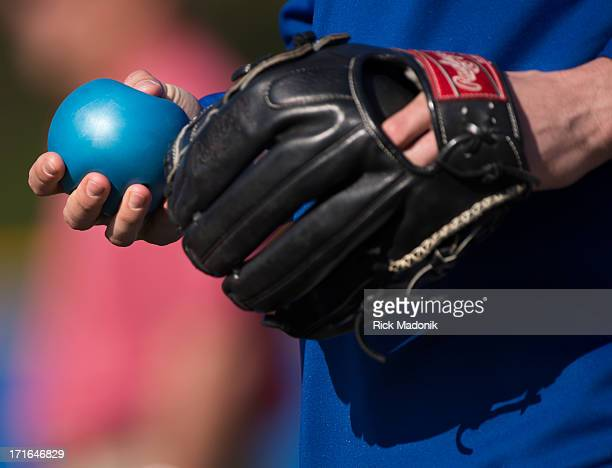 130219 DUNEDIN FLORIDA Pitcher Steve Delabar uses one of his balls he credits with improving his pitching as he waits on a drill Toronto Blue Jays...