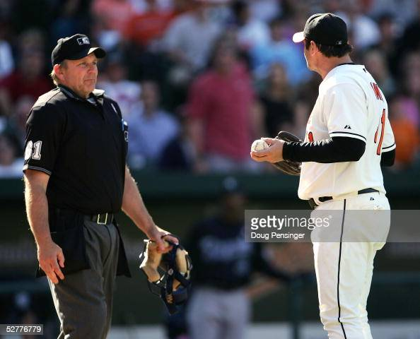 Pitcher Steve Kline of the Baltimore Orioles protests to home plate umpire Bob Davidson on a balk call that allowed Angel Berroa of the Kansas City...