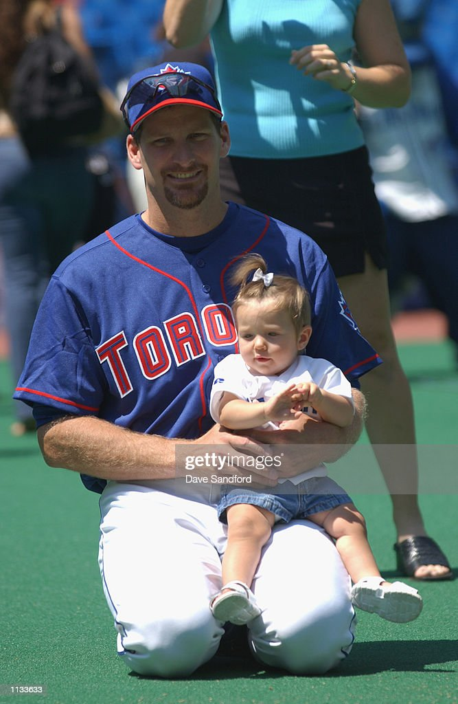 Pitcher Steve Parris #39 of the Toronto Blue Jays holds daughter Lisa on his lap during the annual kids ball game on July 14, 2002 at the Skydome in Toronto, Canada. The Blue Jays edged the Red Sox 6-5.